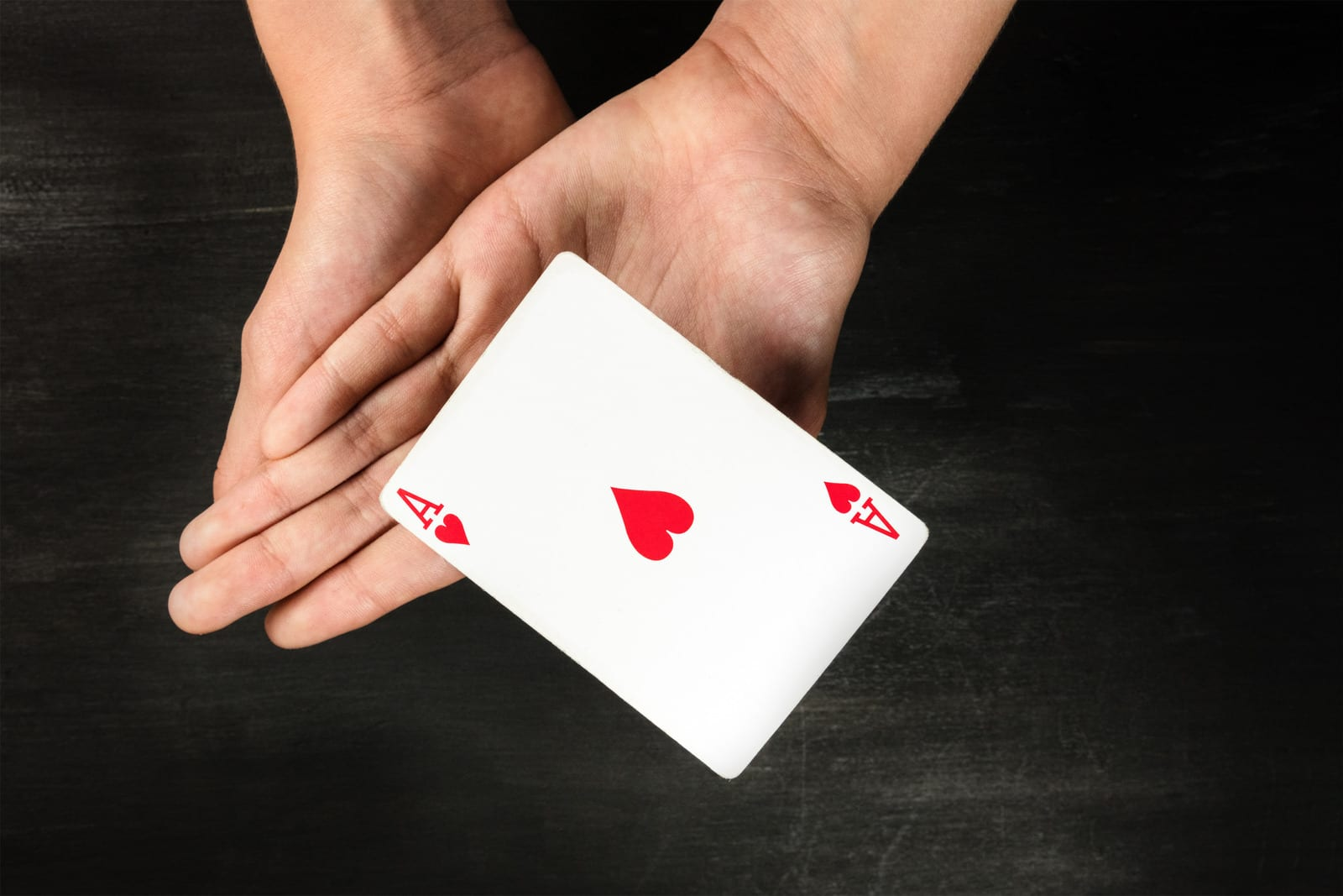 Card levitating above girls hands with copyspace